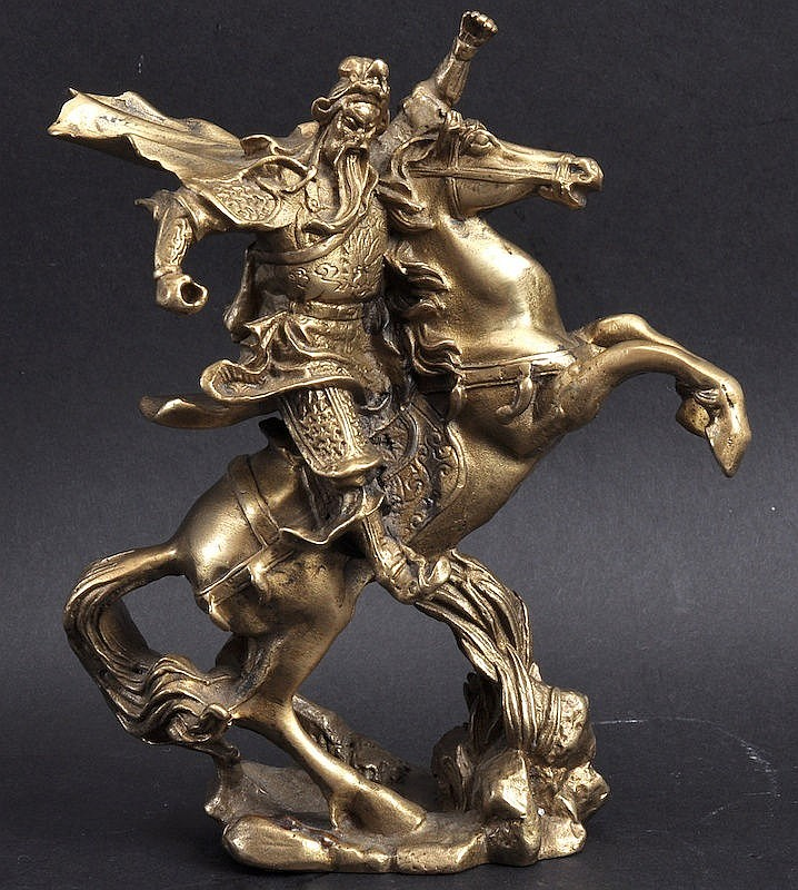 A CHINESE GILT BRONZE FIGURE OF A WARRIOR modelled