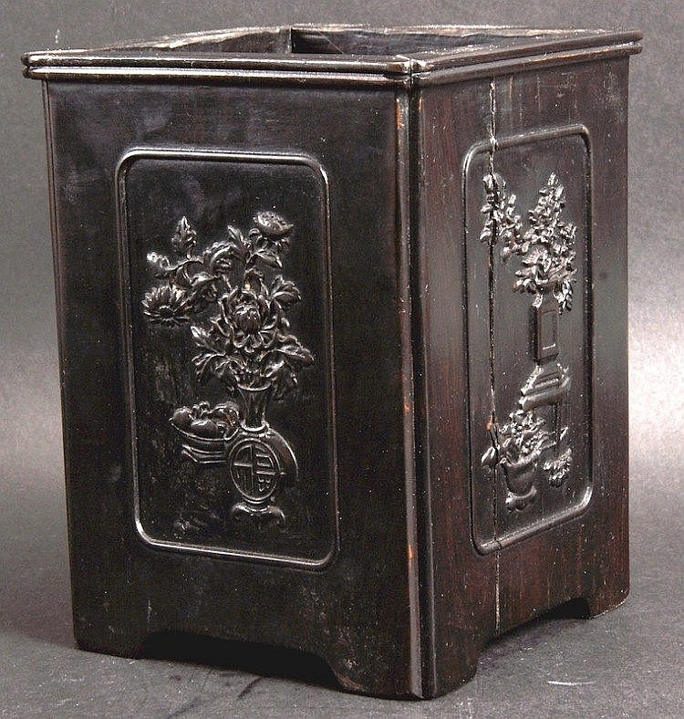 A CHINESE QING DYNASTY CARVED HARDWOOD BRUSH POT