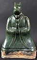A 19TH CENTURY CHINESE GREEN GLAZED FIGURE OF A