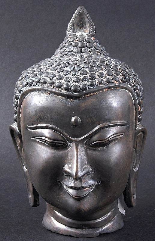 A SOUTH EAST ASIAN BRONZE BUDDHIST HEAD with flame