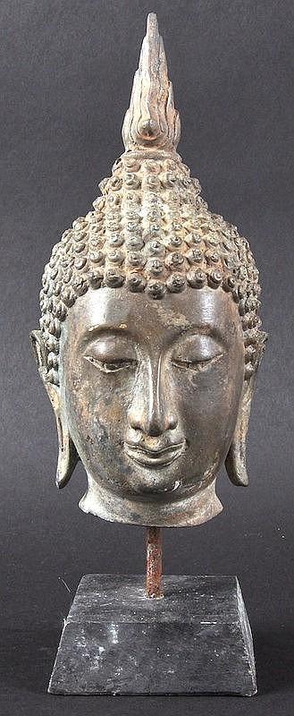A 19TH CENTURY SOUTH EAST ASIAN BRONZE BUDDHA HEAD