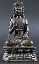 A 16TH/17TH CENTURY CHINESE BRONZE FIGURE OF