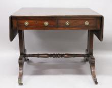A 19TH CENTURY MAHOGANY SOFA TABLE, with rounded rectangular top, two frieze drawers on plain end supports, a single turned stretcher on sabre legs with brass castors. <br>3ft 0ins wide x 2ft 6ins deep x 2ft 5ins high.