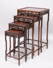A NEST OF FOUR CHINESE HARDWOOD TABLES, 20TH CENTURY, each with a carved frieze on slender legs. <br>Largest: 1ft 4ins wide x 1ft 1ins deep x 2ft 4ins high.