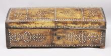 AN EARLY VELLUM COVERED AND METAL STUDDED DOME TOP TRUNK. <br>3ft 2ins long x 1ft 6ins deep x 1ft 2ins high.