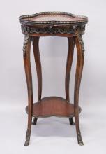 A FRENCH MAHOGANY, MARQUETRY AND ORMOLU TWO TIER OCCASIONAL TABLE, of trefoil shape with galleried top on slender legs. <br>1ft 6ins wide x 2ft 11ins high.