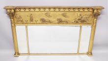 A GOOD 19TH CENTURY GILT WOOD OVERMANTLE MIRROR, with broad frieze applied with a chariot, lions and figures over three mirror plates flanked by classical columns. <br>4ft 11ins long x 2ft 11ins high.