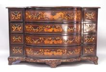 AN 18TH CENTURY DUTCH MAHOGANY AND MARQUETRY INLAID CHEST, with four central bowfront drawers flanked by four small drawers to each side, the whole profusely inlaid with urns of flowers, birds and floral motifs, on bracket feet. <br>4ft 4ins wide x 2ft 9ins high x 1ft 11.5ins deep.
