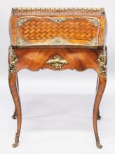 A GOOD 19TH CENTURY KINGWOOD, ORMOLU AND PARQUETRY INLAID BUREAU, IN THE MANNER OF LINKE, with galleried top, the fall flap enclosing three drawers and a well, supported on cabriole legs. <br>2ft 4ins wide x 2ft 10ins high x 1ft 4ins deep.