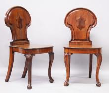 A GOOD PAIR OF 19TH CENTURY MAHOGANY HALL CHAIRS by A. BLAIN, LIVERPOOL, with shield shaped backs, solid seats, on carved cabriole legs with scroll feet.