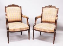 A GOOD PAIR OF LOUIS XV DESIGN ARMCHAIRS, CIRCA. 1880, carved cresting rails and arms, padded back and seats, and supported on tapering legs.