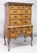 AN 18TH CENTURY WALNUT CHEST-ON-STAND, the top with two short and three long graduated drawers on a base with one long and three small drawers, all with engraved brass handles and supported on later cabriole legs. <br>5ft 8ins high, 3ft 4ins wide.