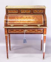 A SUPERB LOUIS XVI STYLE MARQUETRY KINGWOOD BUREAU, CIRCA. 1700, with veined marble top, pierced brass gallery with three small drawers, over a cylinder front with sliding leather writing surface, one long drawer below rich ormolu mounts and tapering legs. <br>2ft 11ins wide, 1ft 8ins deep, 5ft 9ins high. <br>(Note: The marquetry inlay is all-over).