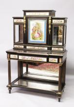 A GOOD 19TH CENTURY FRECH EBONY AND PORCELAIN DISPLAY CABINET, the top with a large central Sevres type porcelain door painted with young lovers, glass doors to the sides, central drawer and six small porcelain panels on a base with long frieze drawers with three porcelain panels, supported on turned legs with mirrored back and plates. <br>5ft 2ins high, 4ft 2ins wide
