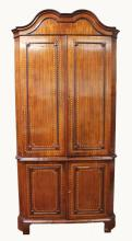A LARGE 19TH CENTURY DUTCH MAHOGANY INLAID STANDING CORNER CUPBOARD, with double domed top with panel doors, enclosing three shaped shelves with double panel doors to the base, and supported on bracket feet. 6ft 11ins high, 3ft 7ins wide.