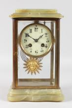 A 19TH CENTURY FRENCH ONYX FOUR GLASS CLOCK of serpentine shape, with eight-day movement and sunburst pendulum. <br>10.5ins high.