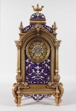A SUPERB 19TH CENTURY FRENCH CHAMPLEVE ENAMEL MANTLE CLOCK, Retailed by MILLER & SONS, with eight-day movement, No. 22583, stamped MS in an oval, the ormolu case with rich champleve panels and urn surmount. <br>18ins high.