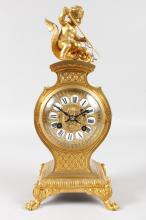 A GOOD 19TH CENTURY FRENCH ORMOLU MANTLE CLOCK, eight-day movement, striking on a single bell, the movement stamped MB with hammer in an oval and surmounted by a cupid riding a dolphin. <br>13ins high.