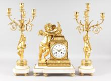 A SUPERB 19TH CENTURY FRENCH ORMOLU AND WHITE MARBLE THREE PIECE MANTLE CLOCK SET, Retailed by DUTERTRES A. PARIS, the eight-day movement with white enamel dial, black and white Roman numerals, striking on a single bell. movement No. 1343, the case with a winged cupid holding a cartouche, 16ins high, complete with a pair of five light candelabra, 20ins high.