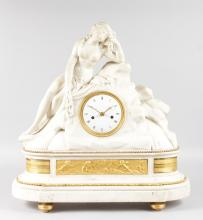 A SUPERB 19TH CENTURY FRENCH CARVED WHITE MARBLE MANTLE CLOCK, the case as a superb carved white marble reclining nude, with eight-day movement with circular dial, ormolu panels with cupids and supported on ormolu feet. <br>21ins high, 21ins long.