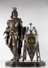 A LARGE AND IMPOSING 19TH CENTURY BRONZE FRENCH KNIGHT CLOCK formed as a Knight in suit of armour, holding a shield, the clock movement set in a shield with clubs and swords, movement 2123, eight-day striking on a single bell and standing on a marble base. <br>37ins high, 22ins wide.