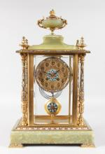 A GOOD LARGE 19TH CENTURY FRENCH ONYX AND CHAMPLEVE ENAMEL CLOCK with eight-day movement, urn finial and column sides and bevelled glass, supported on champleve enamel bracket feet. <br>19ins high.