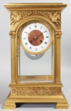 A GOOD FRENCH EMPIRE GILT BRONZE FOUR GLASS CLOCK, with eight-day movement, column supports and flying horses motifs, supported on bracket feet. <br>15ins high.