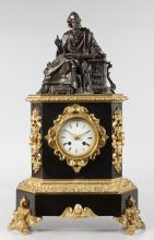 A GOOD 19TH CENTURY FRENCH MANTLE CLOCK, surmounted with a bronze figure of a scribe, the rosewood case mounted in ormolu with white circular dial and eight-day movement. <br>Bears Label: MUDESSE MARBIER BREVETE. <br>23ins high.