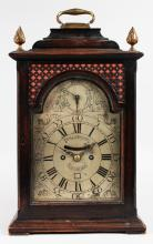 AN 18TH CENTURY SCOTTISH BRACKET CLOCK by WILL DOWNIE, EDINBURGH, CIRCA. 1765, with silvered dial, silent and strike action, eight-day movement, date aperture with double fusee movement, the case with fret sides, two brass finials and brass carrying handle. <br>17ins high.