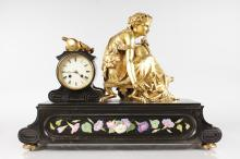 A SUPERB 19TH CENTURY FRENCH GILT BRONZE AND BLACK MARBLE CLOCK, with circular drum movement striking on a single bell, the case with a seated classical female figure holding a lyre, the front with black marble inlaid with flowers on various coloured marbles. <br>18ins high, 25ins wide.