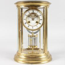 A 19TH CENTURY FRENCH BRASS OVAL FOUR GLASS EIGHT-DAY CRYSTAL REGULATOR CLOCK by S. MARTI & CIE. <br>12ins high.