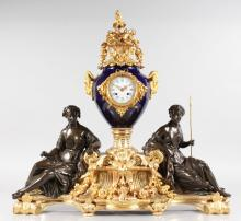A FABULOUS QUALITY LOUIS XVI BRONZE, ORMOLU AND BLUE PORCELAIN MANTLE CLOCK by LE ROY & FILS, PALAIS ROYAL A PARIS, RUE MONTPRESSIER 13-15, MEDAILLE A LEXPON DE LONDRES 1851, the eight-day movement with circular white enamel dial, blue and white Roman numerals and striking on a single bell, contained in a blue SEVRES porcelain urn with ormolu urns and ram masks, the base with two classical bronze female figures and rich ormolu with acanthus and swags. <br>2ft 3ins high, 2ft 4ins wide. <br>THIS CLOCK WAS MADE FOR THE GREAT EXHIBITION LONDON 1851 AT CRYSTAL PALACE.
