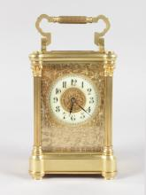 A GOOD 19TH CENTURY FRENCH BRASS CARRIAGE CLOCK with reeded column sides and filigree face. <br>6.25ins high.