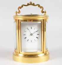 A GOOD 19TH CENTURY FRENCH BRASS OVAL CARRIAGE CLOCK, stamped Japy Freres et Cie, Exposition 1888, Grande Med. D'Honneur.