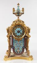 A VERY GOOD 19TH CENTURY FRENCH CHAMPLEVE ENAMEL CLOCK, with urn finial, ribbon motifs and garlands, on a shaped base, the eight-day movement stamped JT 3070. <br>19ins high.