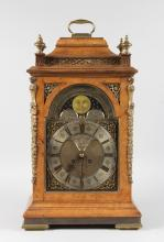 A GEORGE III MAHOGANY BRACKET CLOCK CASE with dial by C. TOMAS CHEFFIELD, LONDON. <br>23ins high.