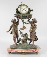 A 19TH CENTURY SPELTER FRENCH DRUM MANTLE CLOCK held aloft by a boy and girl standing on a serpentine fronted marble base. <br>26ins high.