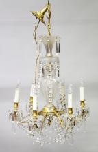 A GOOD LOUIS XVI DESIGN FROSTED CRYSTAL AND ORMOLU SIX LIGHT HANGING CHANDELIER with cut crystal prism drops and garlands. <br>27ins long, 19ins wide.