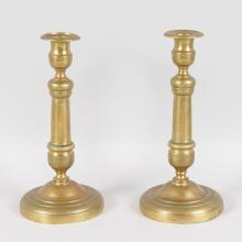 A PAIR OF 18TH CENTURY FRENCH ORMOLU CIRCULAR ETCHED CANDLESTICKS. <br>10.5ins high.
