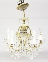 A 20TH CENTURY CUT GLASS AND BRASS CHANDELIER, with five scrolling branches, having cut glass pans, swags and drops.. <br>1ft 10ins high.