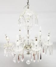 A 20TH CENTURY CUT GLASS CHANDELIER, with a canopy top, baluster column and six scrolling branches, all with cut glass pans, swags and drops. <br>2ft 8ins high.