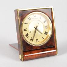A JAEGER-LECOULTRE TORTOISESHELL FOLDING TABLE WATCH, No. 1191993, in a leather case.