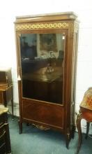 A GOOD 19TH CENTURY LOUIS XVI DESIGN KINGWOOD VITRINE with marble top, ormolu frieze over a long glass door enclosing three shelves, supported on curving legs. <br>5ft 10ins high, 2ft 8ins wide.