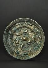 Silvered Bronze Tang Dynasty Lion and Grape Mirror