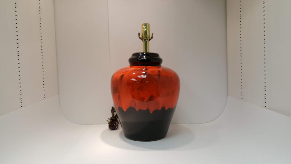 A Mid Century Black And Redish Orange Ceramic Table Lamp