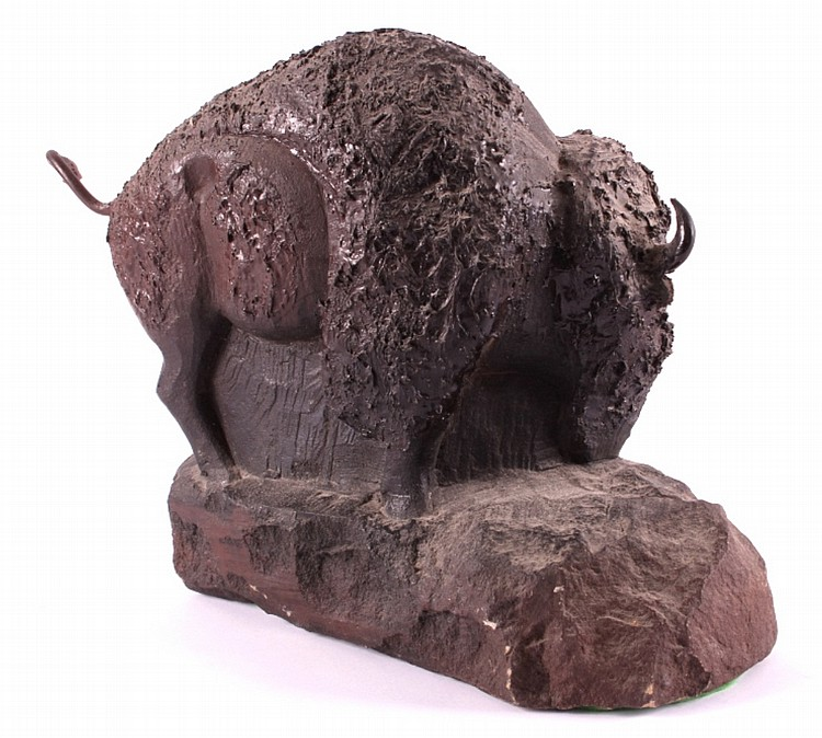 Native american carved stone buffalo statue