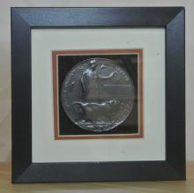 Lot 8: A framed miniature WW1 British Military Dead Mans Penny.
