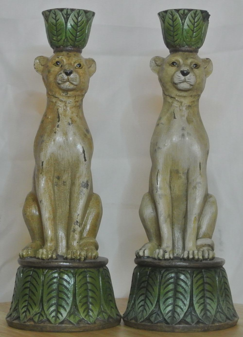 An unusual pair of antique style cheetah candlesticks