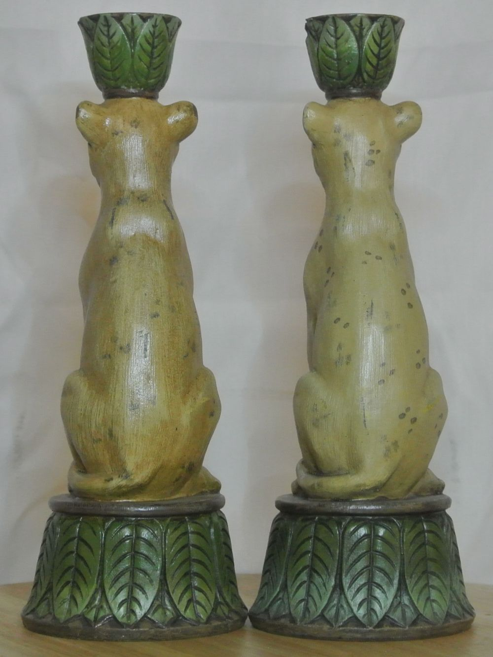 Lot 31: An unusual pair of antique style cheetah candlesticks