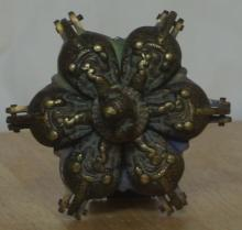 Lot 39: An unusual antique brass Islamic paint palette